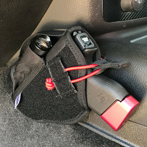 Transporting weapon in car gun holsters